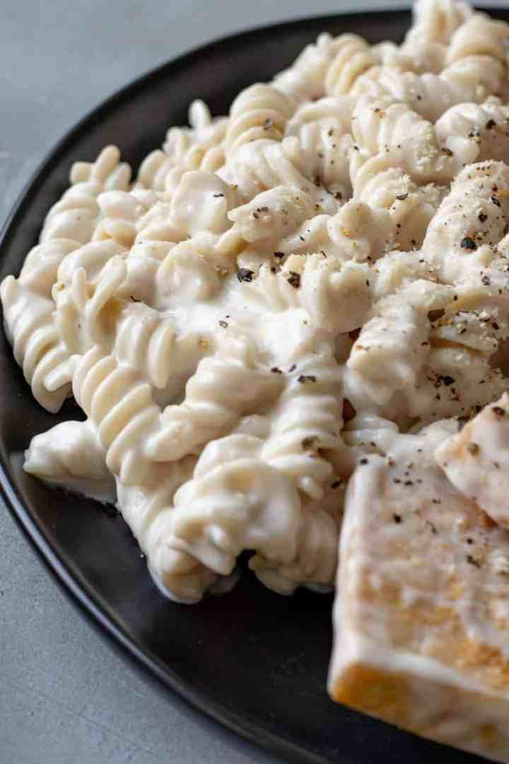 creamy lemon sauce on gluten-free pasta with tofu