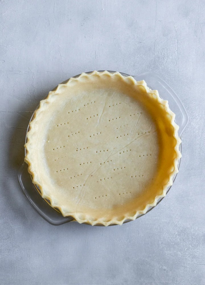 overhead view of vegan gluten free pie crust in a pie plate