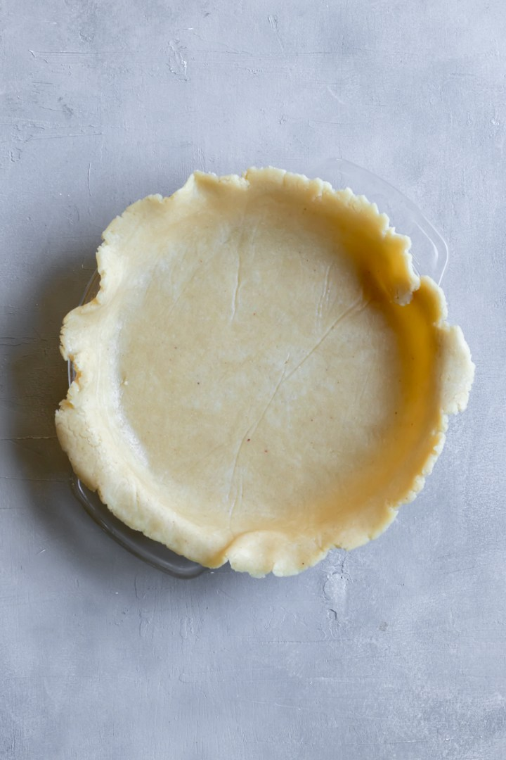 easy vegan pie dough in glass pie plate, ready to be decorated and baked