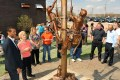 Visitors take a look at the new memorial honoring linemen that work for Com Ed in Cyrstal Lake, Ill. The scupture, which was unveiled in March, honors linemen who died in service, including Kelly Skiles of Lyons.