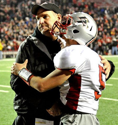 Big Foot coach Rodney Wedig hugs former player Carter Hehr after the team's heartbreaking state final loss last season.