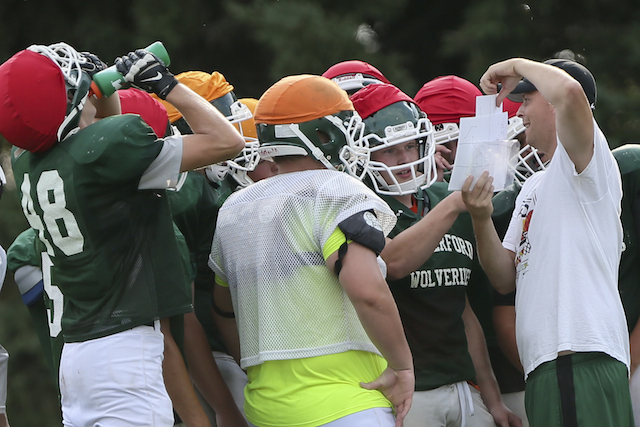 Waterford players huddle up at Monday's practice. (Rick Benavides/Waterford Post)