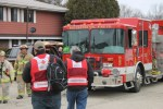 Two members from The American Red Cross Disaster Relief team arrive to a Village of Rochester apartment complex at 300 E. Spring St. to offer assistance to residents in need (Jason Arndt/Standard Press)