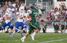 Tanner Keller makes a dash for the end zone in an early season Waterford win (File Photo/Standard Press).