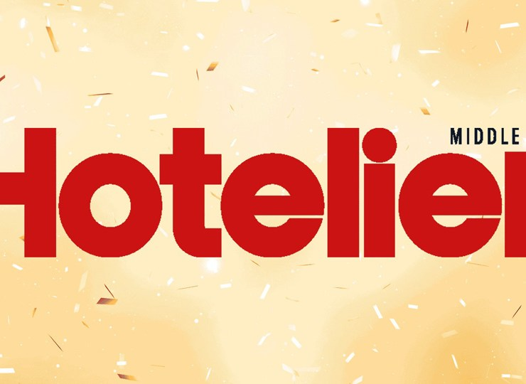 Logo for the online publication Hotelier Middle East, cream background with Hotelier Text in Red
