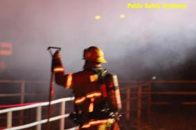 A firefighter prepares to assist with battling the fire. Robert Carter photo