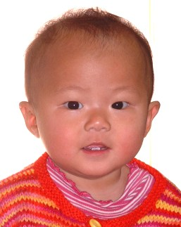 My new Canadian posing for her first Canadian passport photo a few days before leaving China