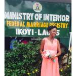Bride happily shows off her marriage certificate