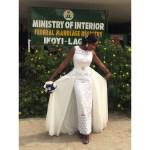 Bride shows off her dress