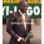 Groom shows off the marriage certificate