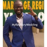 Handsome groom shows off his wedding ring