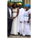 Couple shows off their marriage certificate as they pose with Bride's parents