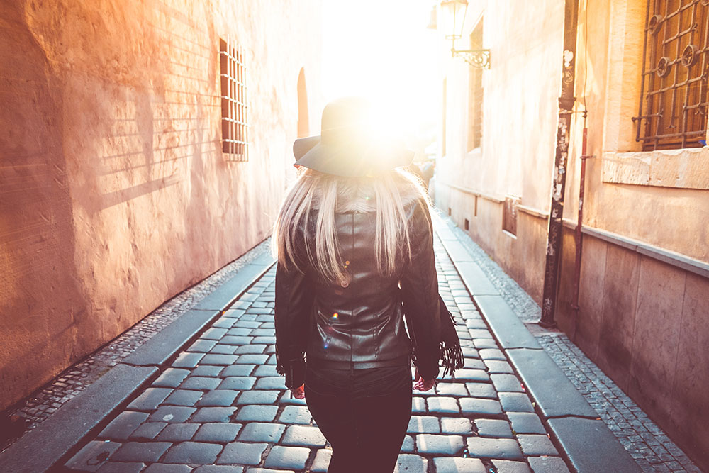 Young Woman Walking Alone in Prague Streets