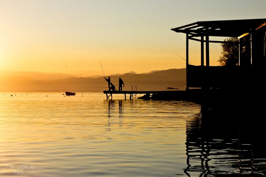 fishermen on the lake Ohrid in Macedonia at sunset