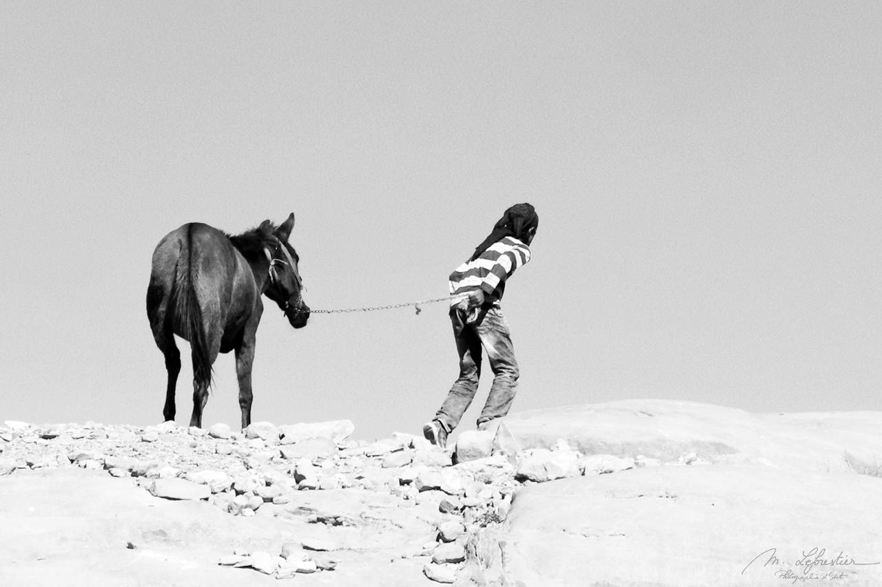bedouin kid and donkey in Petra Jordan