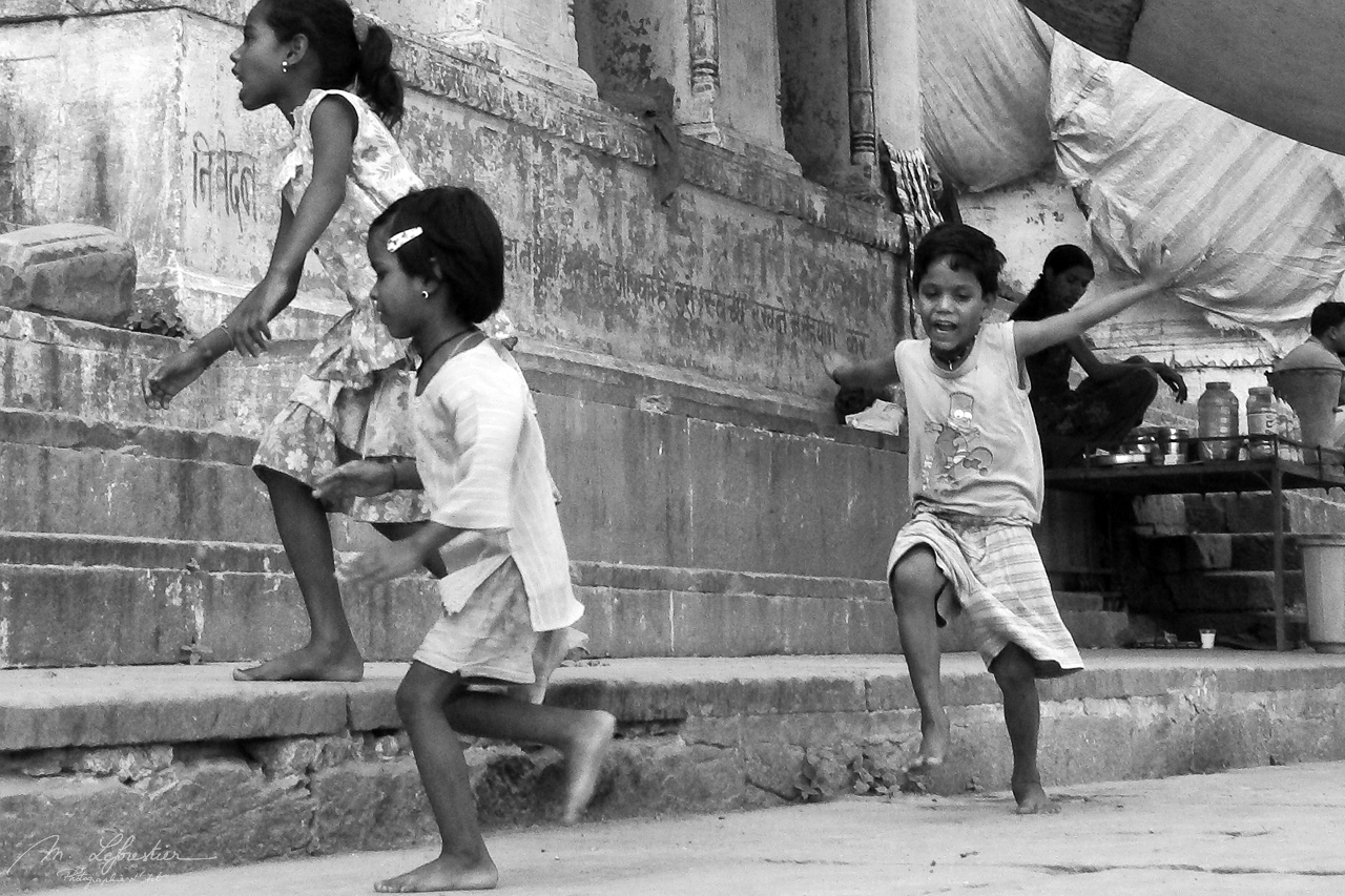 kids running in Varanasi India black and white photo