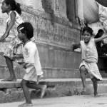 kids running in Varanasi India black and white photo