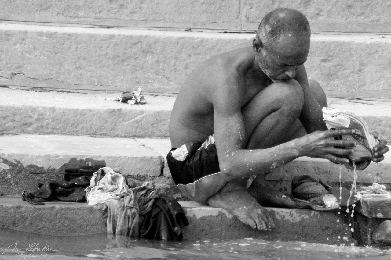 Man washing in Varanasi Banaras India