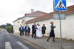 wedding crew walking in the Mir village in Belarus