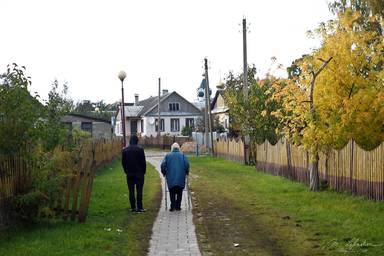 locals walking in the Mir village in Belarus