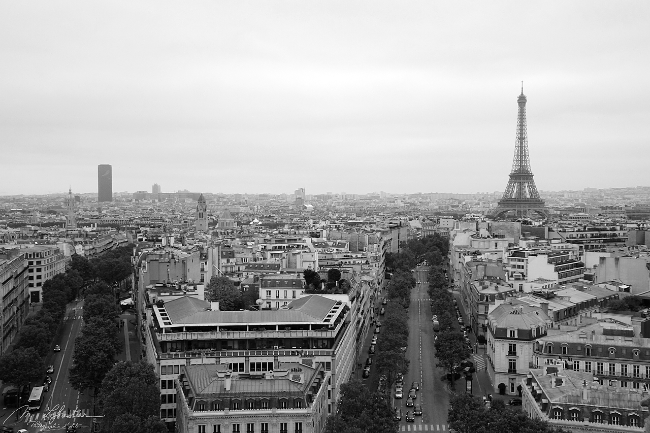 view of Paris and the Eiffel Tower from the top of the Arc de Triomphe in Paris