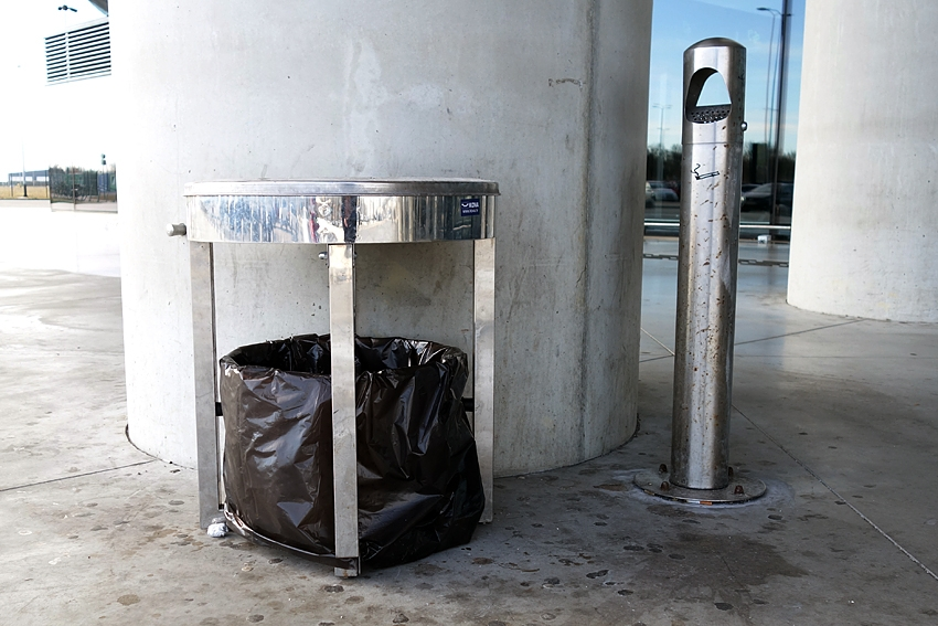 a silver litter bin with its matching ashtray at the airport in Zagreb croatia