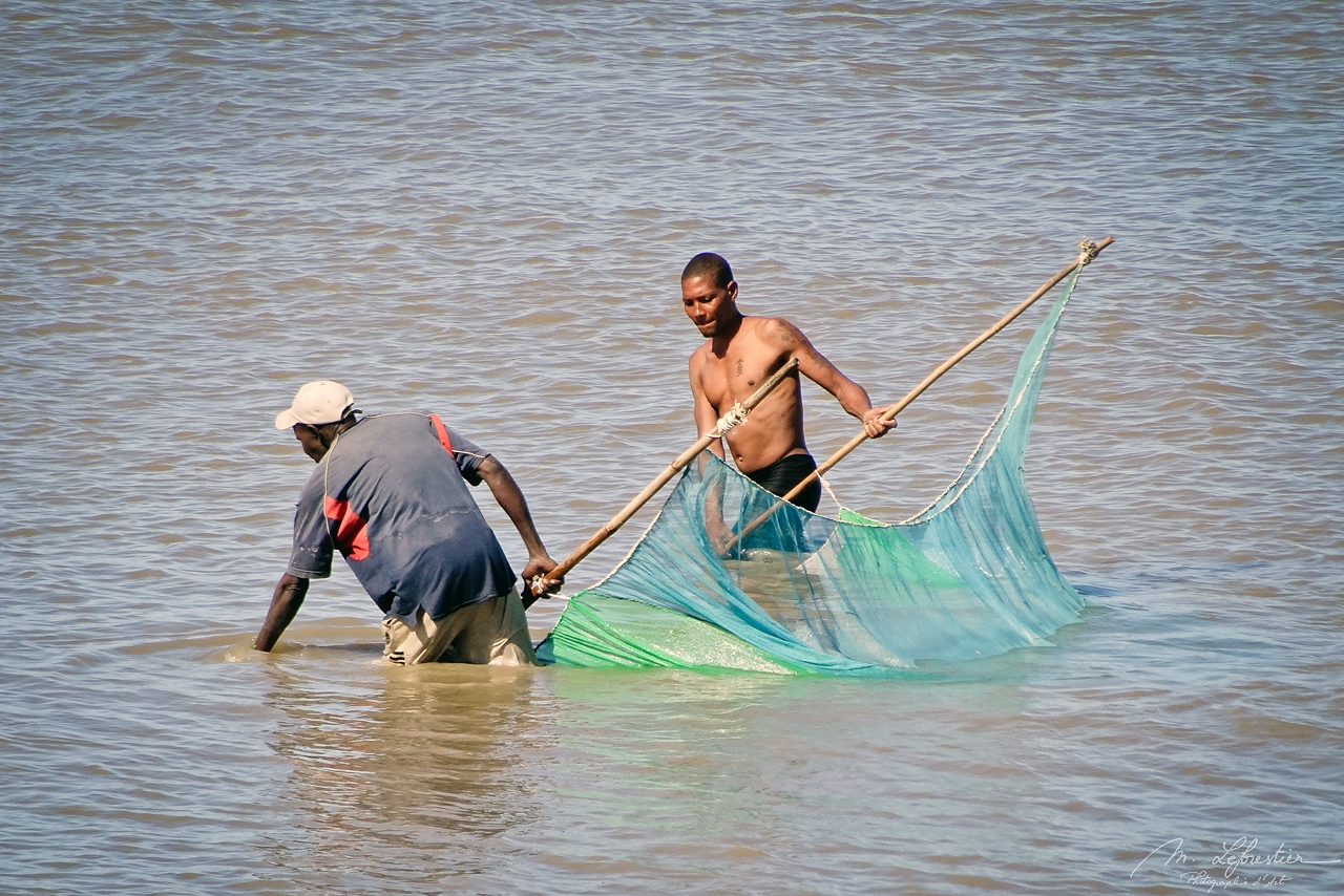 two men fishing in the indian ocean in Beira Mozambique