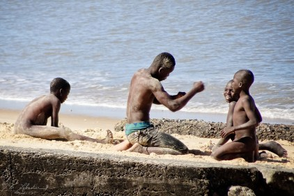 kids playing in the sand on the sea front in Beira Mozambique indian ocean beach