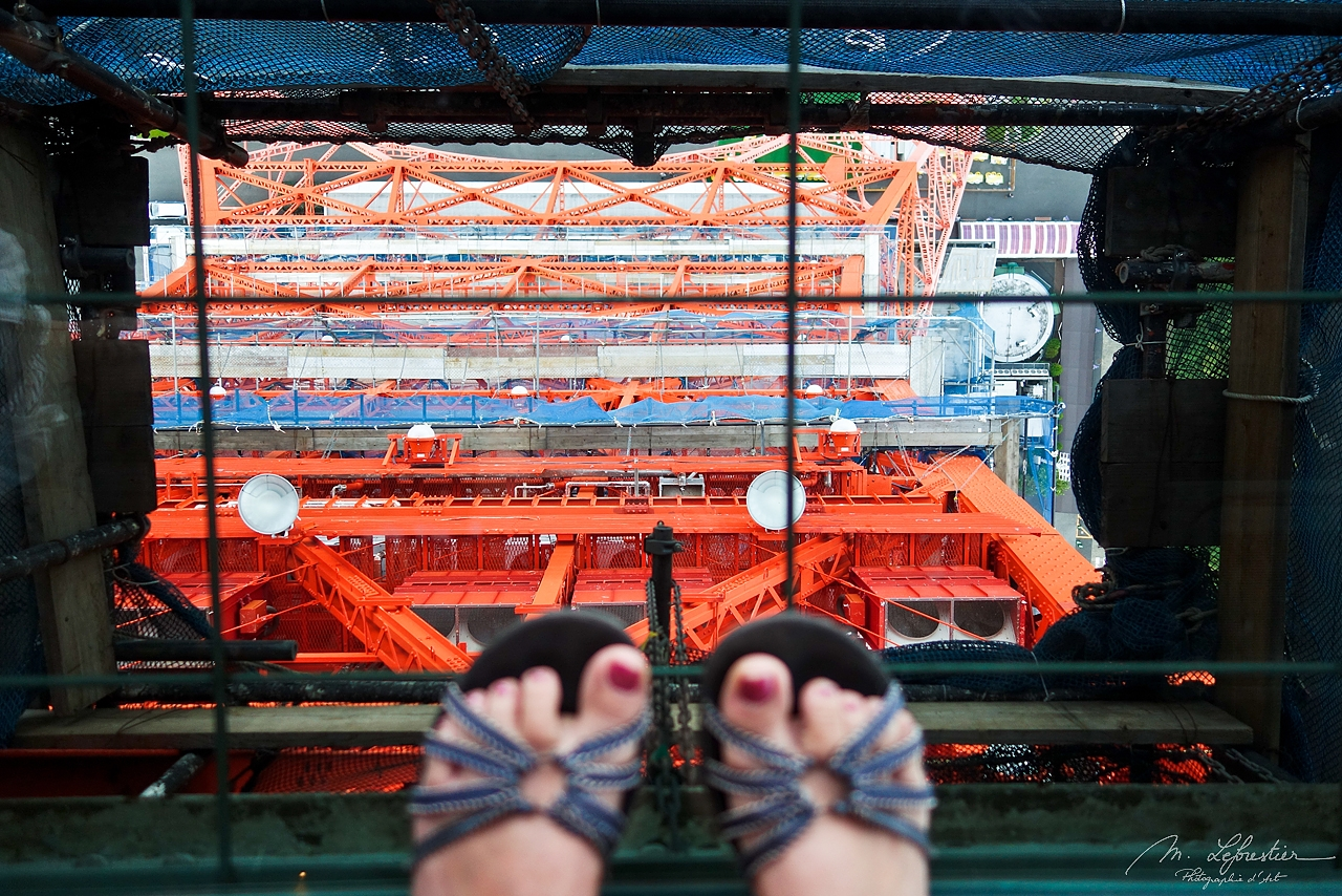 looking down at my feet from the Tokyo Tower in japan