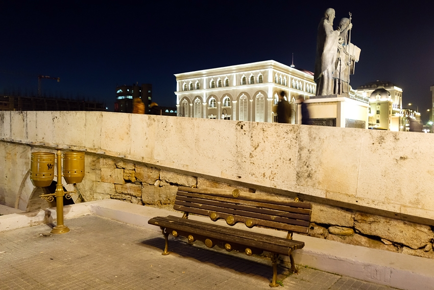 a double litter bin by a bench by night in the city of Skopje Macedonia