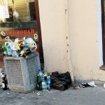 a full street litter bin during the white nights of Saint Petersburg Russia