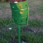 A green litter bin in Durres, Albania