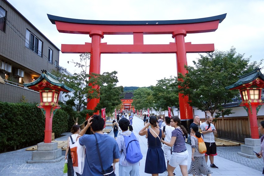 tourists walking towards the Fushimi Inari Shrine in Kyoto Japan