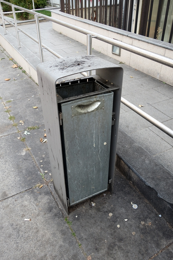 a grey litter bin in a street of Prishtina in Kosovo