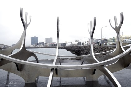 Sun voyager sculpture in Reykavik Iceland with view on the city on a grey day