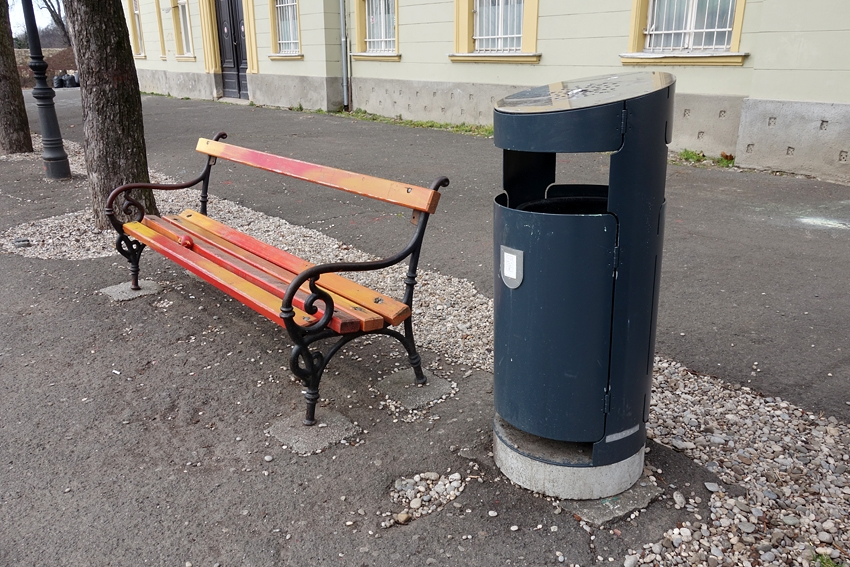 a street litter bin by a bench in Zagreb the capital of Croatia