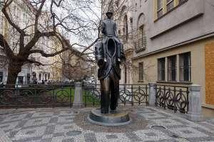 statue of Franz Kafka sitting on a headless figure in a little square on Dusni street in Prague in the Czech Republic, sculpture by Jaroslav Róna