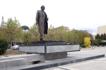 the giant lego of 4 meters high behind a statue of Ibrahim Rugova in Pristina Kosovo