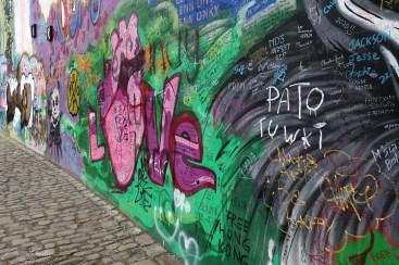 colorful paintings on the John Lennon Wall in the Czech republic capital Prague