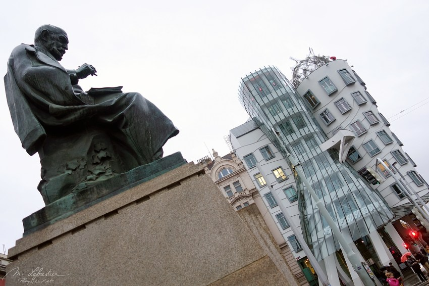 The statue of Alois Jirasek is a sculpture made by Karel Pokorný and Jaroslav Fragner., and it is located in front of the Dancing House