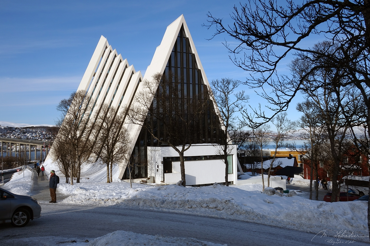 view of the Arctic Cathedral in Tromso on a very snowy day in Tromsdalen