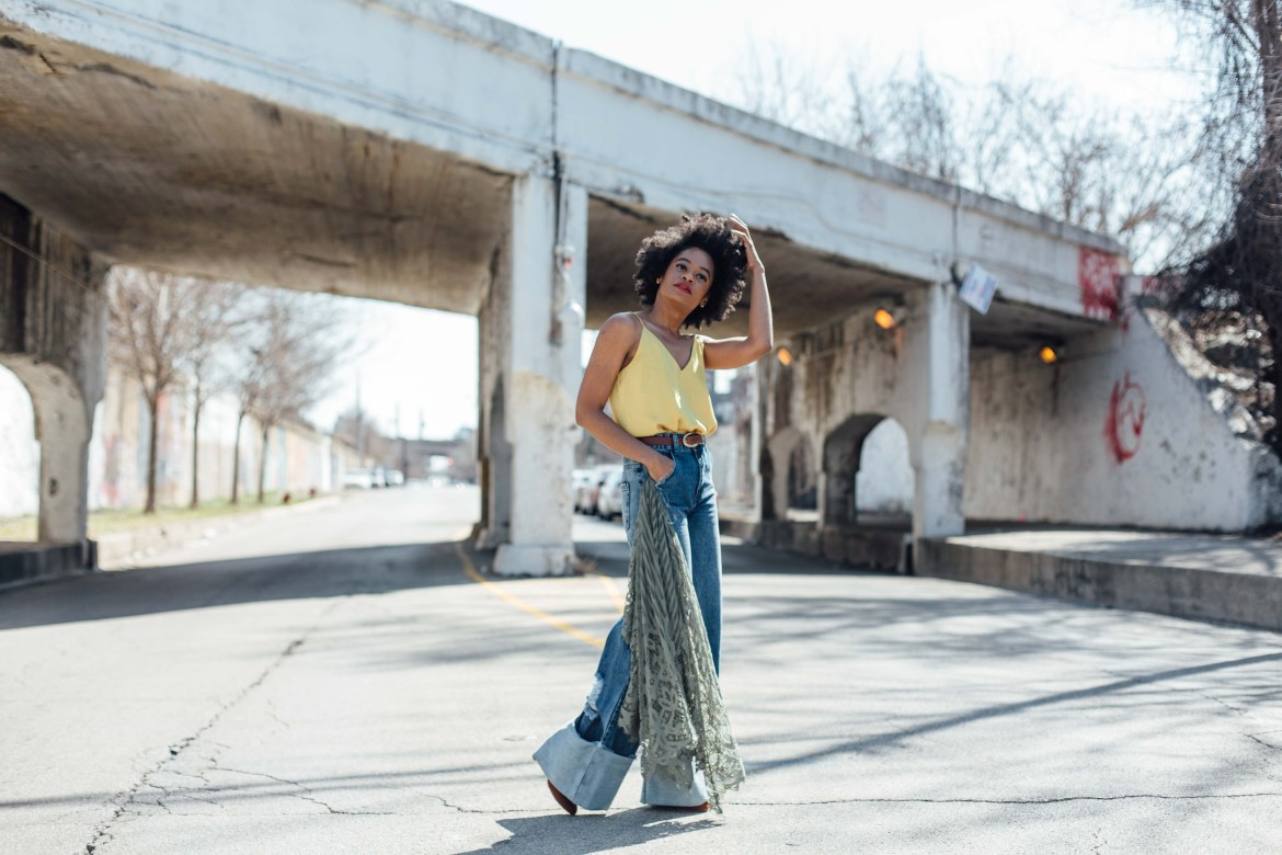Wide leg denim jeans and gold tank
