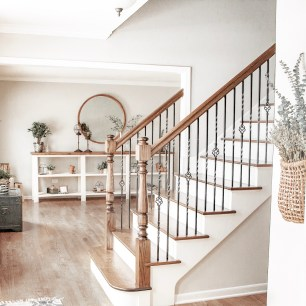 Home design choice to update stairs to White and wood with rod iron spindles or railing