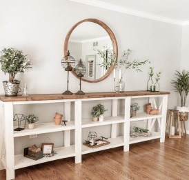 Round mirror above long entryway table. Rustic table, wood and white table, farmhouse table. DIY table