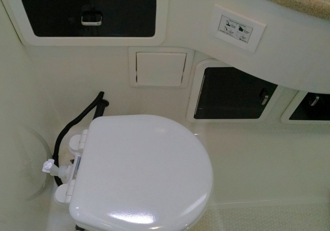 Installed electric toilet and control panel