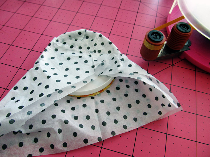 fold and wrap the tissue around the lid