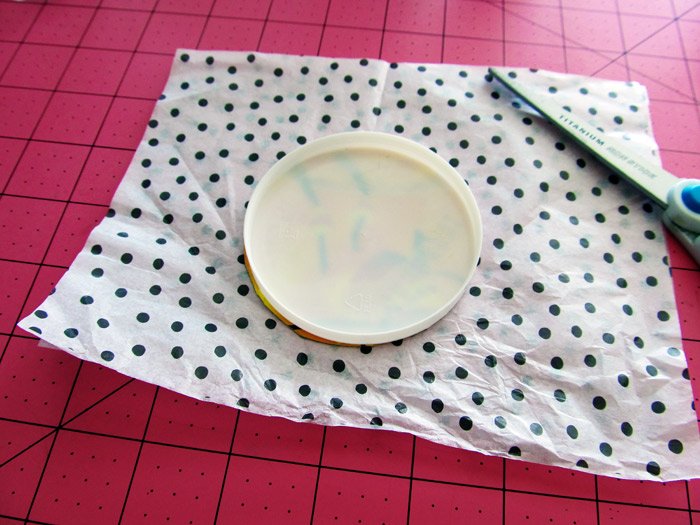 place lid on tissue paper and cut down to size