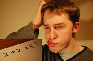 A man having a hard time thinking of numbers