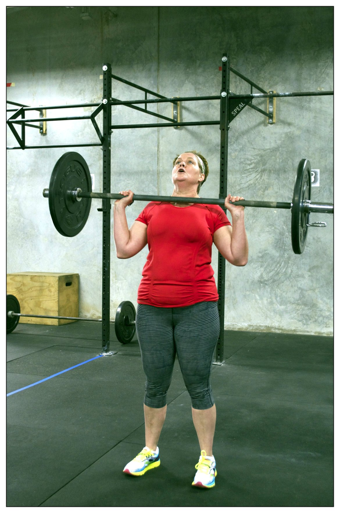 Crossfit Masters Level Competitor, Cathy Lawdanski, performing the Push Press