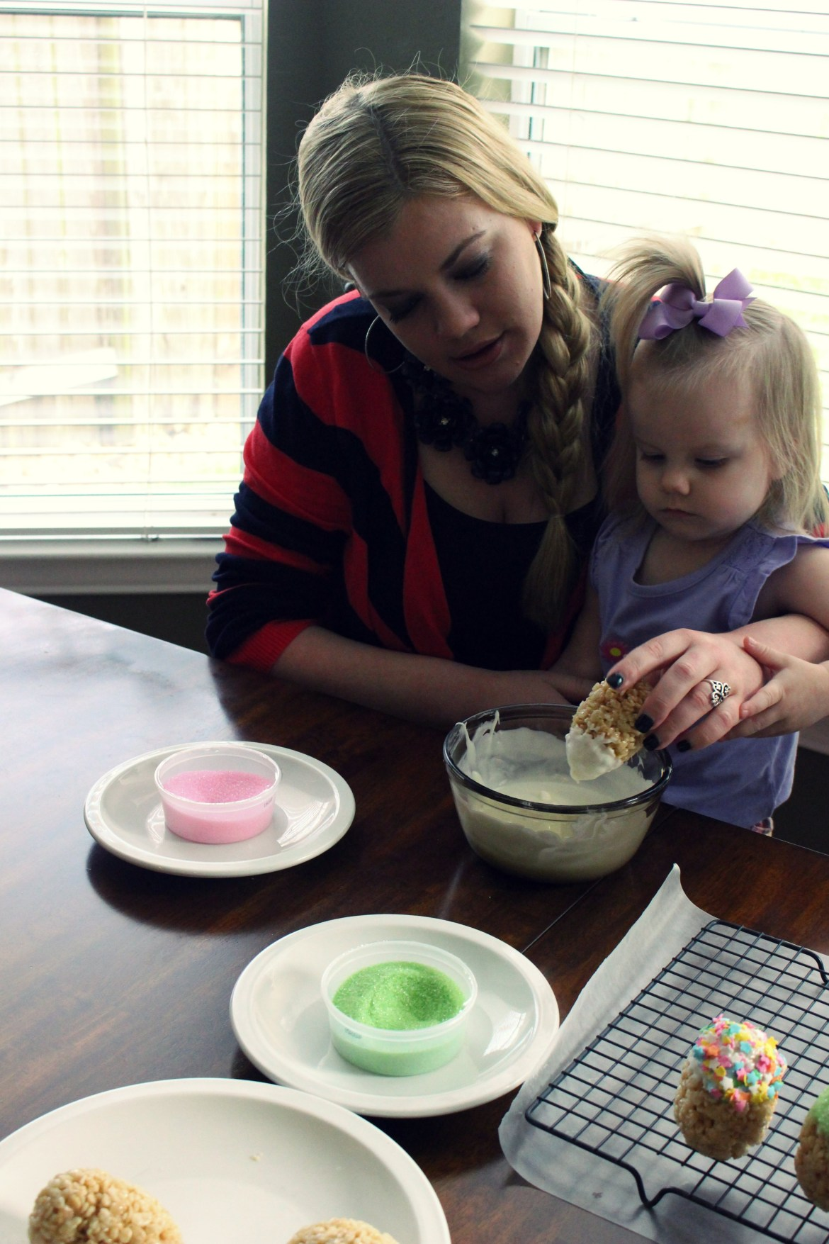 Madeline dipping Dipped Easter Egg Treats with her Mommy, Amy